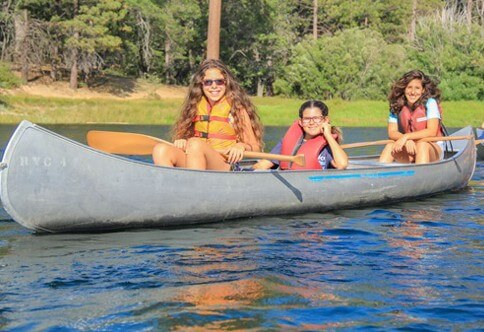 Campers canoeing on Jenks Lake