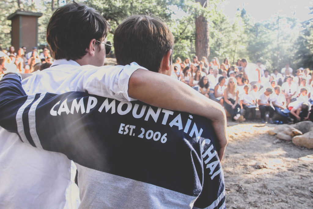 Campers Arm Around Each Other